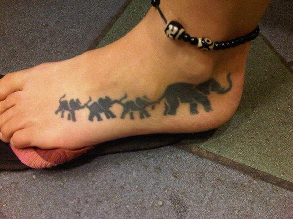 elephant tattoo on foot
